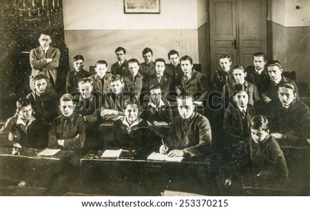 BERLIN, GERMANY, CIRCA 1930's: Vintage photo of schoolboys with their teacher in class - stock photo