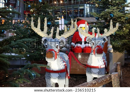BERLIN, GERMANY - DEC 30, 2012: Lego Santa Clause and Lego reindeers at Potsdamer Platz Sony Center in Germany - stock photo