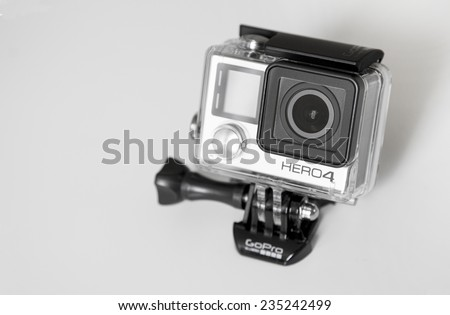 BERLIN, GERMANY - DECEMBER 4, 2014: GoPro HERO4 Black Edition on white background. GoPro HERO4 BLACK is a 4K ultra high-definition extreme action video camera. - stock photo