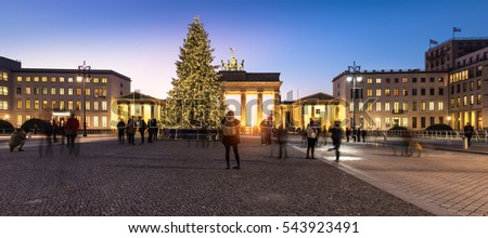 BERLIN, GERMANY - DECEMBER 21, 2016: Panorama of Brandenburger Gate in evening illumination with Christmas tree. Life is going back to normal two days after the terror attack on the Christmas market.