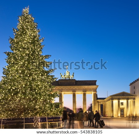 BERLIN, GERMANY - DECEMBER 21, 2016: Panorama of Branderburger Gate in evening illumination with Christmas tree. Life goes back to normal two days after the terror attack on the Christmas market.