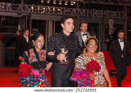 BERLIN, GERMANY - FEBRUARY 14, 2015: Actress Maria Telon, director Jayro Bustamante and actress Maria Mercedes Coroy with the silver bear Alfred-Bauer-Preis during the 65th Berlinale