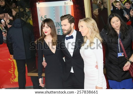 BERLIN, GERMANY - FEBRUARY 11: Jamie Dornan, Dakota Johnson  attend the 'Fifty Shades of Grey' premiere during the 65th Berlinale Film Festival at Zoo Palast on February 11, 2015 in Berlin, Germany. - stock photo
