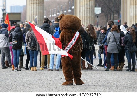 BERLIN, GERMANY - FEBRUARY 14: Man dressed as a bear at the Branderburger Tor, on February 14, 2014 in Berlin, Germany. Bear is a symbol of Berlin.