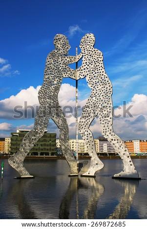 BERLIN, GERMANY - FEBRUARY 2, 2015: Molecule Man sculpture on the Spree river - stock photo