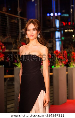 BERLIN, GERMANY - FEBRUARY 14: Olga Kurylenko attends the Closing Ceremony of the 65th Berlinale International Film Festival at Berlinale Palace on February 14, 2015 in Berlin, Germany. - stock photo