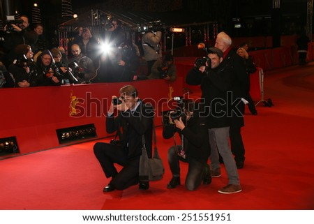 BERLIN, GERMANY - FEBRUARY 09: Photographers attend the 'As We Were Dreaming' premiere during the 65th Berlinale Film Festival at Berlinale Palace on February 9, 2015 in Berlin, Germany. - stock photo