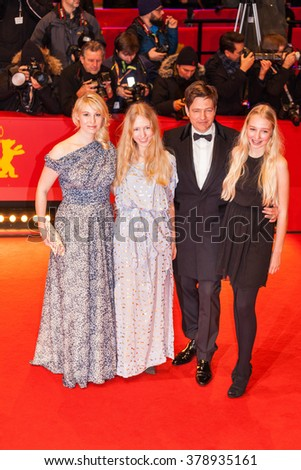 Berlin, Germany - February 17, 2016  - Thomas Vinterberg with his daughters Nana and Ida and actress Helene Reingaard Neumann on 'The Commune' (Kollektivet) premiere during the 66th Berlinale - stock photo
