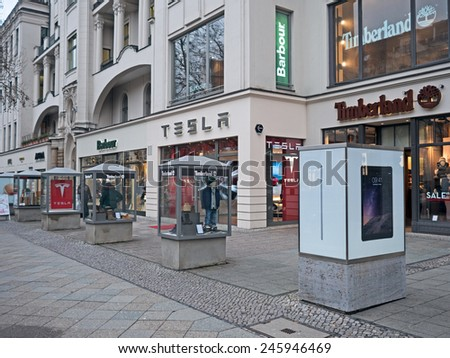 Berlin, Germany - January 21, 2015: Shops of Barbour, Timberland and Tesla in Kudamm, - stock photo