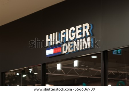 Berlin, Germany - January 11, 2017: Tommy Hilfiger store. Tommy Hilfiger Corporation is a manufacturer of clothing. It produces and sells sporting men's and women clothing. Its office is in Amsterdam
