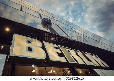 "BERLIN, GERMANY - JULY 23: ""BERLIN"" lettering and reflection of the TV Tower (Fernsehturm) on a glass facade at Alexanderplatz, also known as ""Alex"" on July 23, 2015 in Berlin, Germany, Europe.  - stock photo"