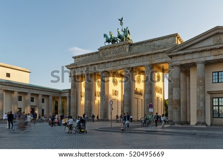 BERLIN, GERMANY - JULY 2015: Brandenburg Gate in Berlin in Germany. The Brandenburg Gate is a triumphal arch, a city gate in the center of Berlin. It is one of the most known sites in Berlin.