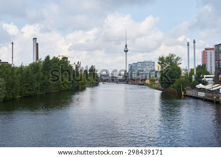 BERLIN, GERMANY - JULY 07: East Berlin cityscape from Spree river, with TV tower prominent in the image . July 07, 2015 in Berlin.
