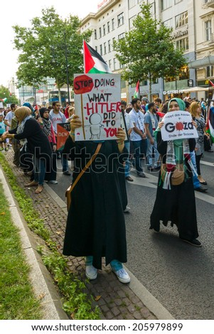 BERLIN, GERMANY - JULY 18, 2014: March of Solidarity with the Palestinian People. Conflict in the Middle East between Israel and Palestine. - stock photo