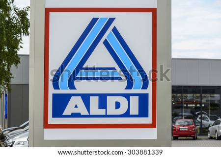 "BERLIN, GERMANY - July 23: the logo of the brand ""ALDI"" at a new supermarket building on Jul 23 2015 in Berlin, Germany, Europe, Aldi is a leading global discount supermarket chain based in Germany.  - stock photo"