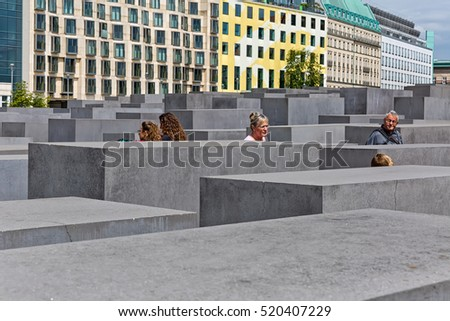 BERLIN, GERMANY - JULY 2015:  View of famous Jewish Holocaust Memorial near Brandenburg Gate in summer on July 27, 2015 in Berlin Mitte, Germany