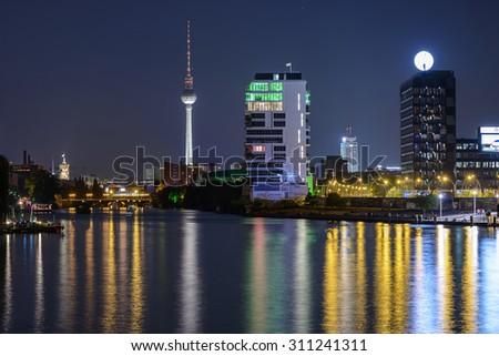 BERLIN, GERMANY - JUNE 12, 2015: Berlin skyline reflecting on Spree river at night on Jun 12 2015 in Berlin - stock photo