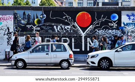 BERLIN, GERMANY - June 17: Berlin Wall graffiti seen on June 17, 2015, Berlin, East Side Gallery. It's a 1.3 km long part of original Berlin Wall which collapsed in 1989. - stock photo