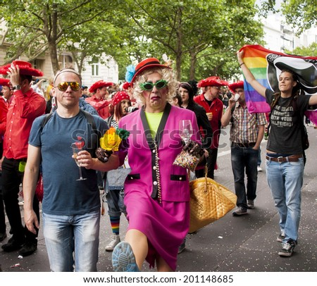 BERLIN, GERMANY - JUNE 21, 2014: Christopher Street Day.Crowd of people Participate in the parade celebrates gays, lesbians and bisexuals.Prominent in the image a elaborately dressed participants.