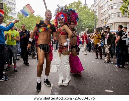 BERLIN, GERMANY - JUNE 21, 2014:Christopher Street Day. Crowd of people Participate in the parade celebrates gays, lesbians, and transgenders. Prominent in the image, elaborately dressed participans.