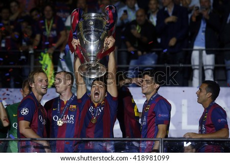 BERLIN, GERMANY- JUNE  2015: FC Barcelona's players celebrate victory  in Uefa Champions League Final football match between Juventus vs Barcellona at the Olympiastadion  on june 6, 2015 in Berlin. - stock photo