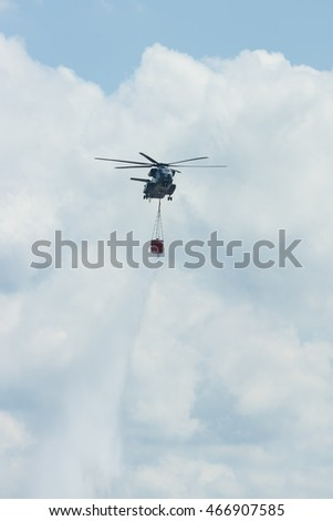 BERLIN, GERMANY - JUNE 02, 2016: Heavy-lift cargo helicopter Sikorsky CH-53 Sea Stallion of the German Army with equipment for fighting fires. Exhibition ILA Berlin Air Show 2016