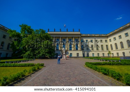 BERLIN, GERMANY - JUNE 06, 2015: Humboldt University in Berlin, nice white architecture with statue outside