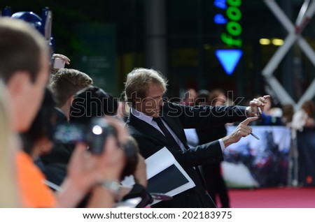 BERLIN - GERMANY - JUNE 29: Michael Bay Selfi with Fans  at the European premiere from Transformer 4 - Age of Extinction at CineStar,Sony Center on June 29, 2014 in Berlin, Germany. - stock photo