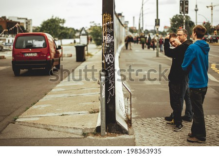BERLIN, GERMANY - JUNE 03: People watching to Berlin Wall on June 03, 2012, Berlin, Germany - stock photo