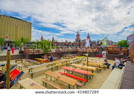 BERLIN, GERMANY - JUNE 06, 2015: Public and beautiful square where people can eat and talk, behind oberbaumbrucke