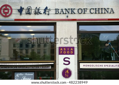 BERLIN, GERMANY - JUNE 21: The showcases of Asian specialty restaurants and the Bank of China on the Potsdam Square on June 21, 2016 in Berlin / Bank of China