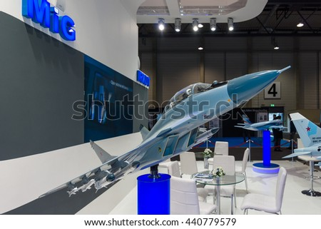 BERLIN, GERMANY - JUNE 01, 2016: The stand of Unated Aircraft Corporation (Russia). Model of Russian fighter aircraft Mikoyan MiG-29M2. Exhibition ILA Berlin Air Show 2016