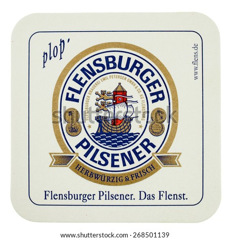 BERLIN, GERMANY - MARCH 15, 2015: Beermat of German beer Flensburger isolated over white background - stock photo