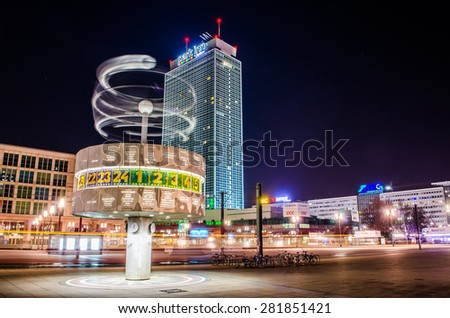 BERLIN, GERMANY, MARCH 12, 2015: Night view of world clock with Park Inn hotel behind situated on Aalexanderplatz in German capital Berlin.