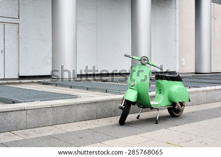 BERLIN, GERMANY - MAY 18, 2015: a parked scooter on the roadside in the city center Berlin