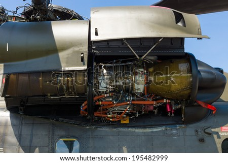 BERLIN, GERMANY - MAY 21, 2014: A turboshaft engine General Electric T64-GE-413 of a heavy-lift cargo helicopter Sikorsky CH-53 Sea Stallion. Exhibition ILA Berlin Air Show 2014