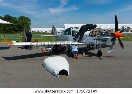 BERLIN, GERMANY - MAY 21, 2014: A two seat Turboprop training and aerobatic low-wing aircraft Grob G 120TP. Exhibition ILA Berlin Air Show 2014