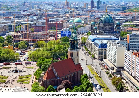 BERLIN, GERMANY - MAY 3, 2014: Aerial view of Berlin. Panorama of Berlin (Neptune fountain, Marienkirche, Berliner Dom) seen from the roof of the hotel Park Inn by Radisson in Alexanderplatz. - stock photo