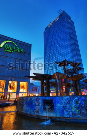 Berlin, Germany - May 16, 2016: Alexanderplatz in Berlin with unidentified people at dusk. is a large public square and a major transport hub in the central Mitte district of Berlin