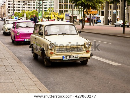 BERLIN, GERMANY - MAY 26, 2015  Berlin, vintage Trabant cars advertising a show in Berlin. Also known as Trabi the vehicle was called the GDR Volkswagen.