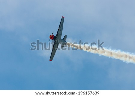 BERLIN, GERMANY - MAY 21, 2014: Demonstration flight of a single-engined advanced trainer aircraft North American T-6 Texan. Flying Bulls Team. Exhibition ILA Berlin Air Show 2014