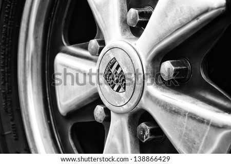 "BERLIN, GERMANY - MAY 11: Detail of the wheel Porsche 911 Targa 2,4 T close-up, (Black and White), ""26. Oldtimer-Tage Berlin-Brandenburg"", May 11, 2013 Berlin, Germany - stock photo"