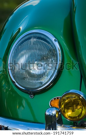 BERLIN, GERMANY - MAY 03, 2014: Headlamp Volkswagen Beetle, closeup. Volkswagen Beetle The most popular car history, produced more than 21 million vehicles. - stock photo