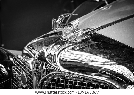 BERLIN, GERMANY - MAY 17, 2014: Hood ornament of the Chrysler Imperial Series CG-Eight, 4-Door Dual Crawl Phaeton (1931). Black and white. 27th Oldtimer Day Berlin - Brandenburg - stock photo