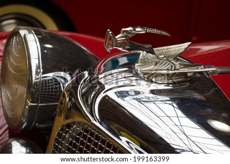 BERLIN, GERMANY - MAY 17, 2014: Hood ornament of the Chrysler Imperial Series CG-Eight, 4-Door Dual Crawl Phaeton (1931). 27th Oldtimer Day Berlin - Brandenburg - stock photo