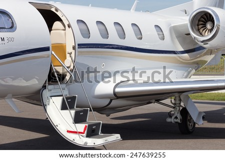 BERLIN, GERMANY - MAY 21: Light business jet Embraer EMB-505 Phenom 300 at the International Aerospace Exhibition ILA on May 21nd, 2014 in Berlin, Germany - stock photo
