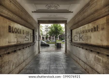 BERLIN, GERMANY - MAY 7 2014: Looking through the communist era buildings during heavy rain on Karl-Marx-Allee in East Berlin, taken on May 7 2014. - stock photo