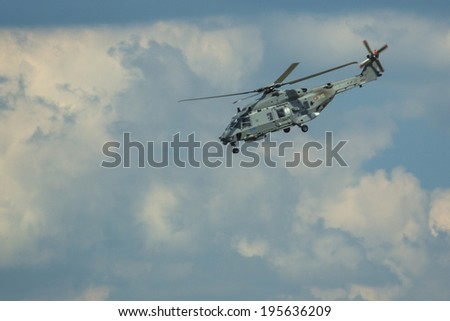 BERLIN, GERMANY - MAY 20, 2014: Multi-role military helicopter NH90 NFH (NHIndustries/France) demonstration during the International Aerospace Exhibition ILA Berlin Air Show-2014.