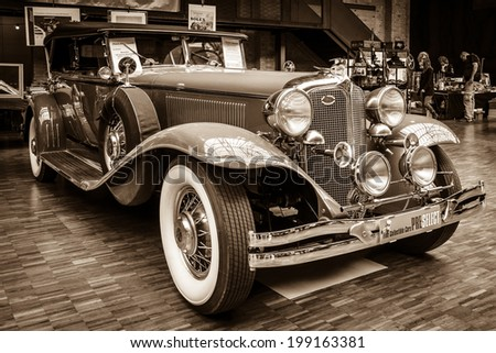BERLIN, GERMANY - MAY 17, 2014: Oldtimer Chrysler Imperial Series CG-Eight, 4-Door Dual Crawl Phaeton (1931). Sepia. 27th Oldtimer Day Berlin - Brandenburg  - stock photo