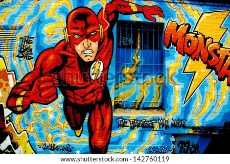BERLIN GERMANY MAY 22: Street art mural of Flash supehero by unknow artist on may 22 2010 in Berlin Germany. - stock photo